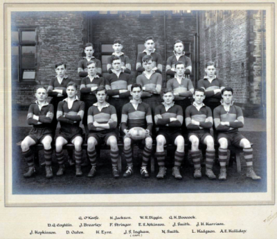 Formal photograph showing seventeen players of the 1933 or 1934 Rugby Team in three rows of seven, six and four from front to back