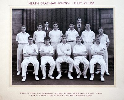 Formal photograph showing eleven players of a 1950s Cricket Team in two rows of five seated and six standing with the scorer and Mr A.E. Carter behind the back row
