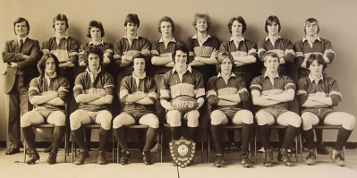 Formal photograph of the 1977/78 Rugby Team in two rows with Tony Edwards on the left