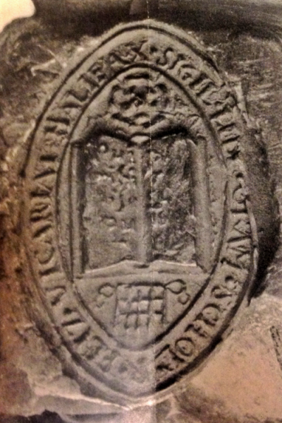 Oval seal with the first text above round the rim and, from top to bottom, a rose, an open book and a portcullis