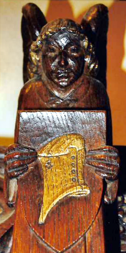 Angel holding a wooden shield on which is engraved the helmet of salvation