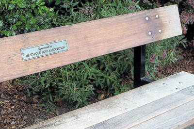 The bench in Crowwood Park showing the plate indicating it was provided by Health Old Boys Association