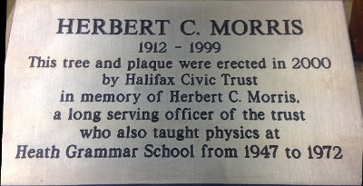 This tree and plaque were erected in 2000 by Halifax Civic Trust in memory of Herbert C. Morris a long serving officer of the Trust who also taught physics at Heath Grammar School from 1947 to 1972