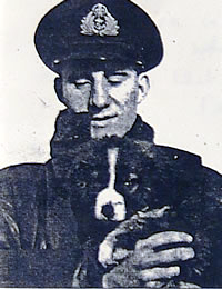 Donald Swift in naval uniform holding a dog